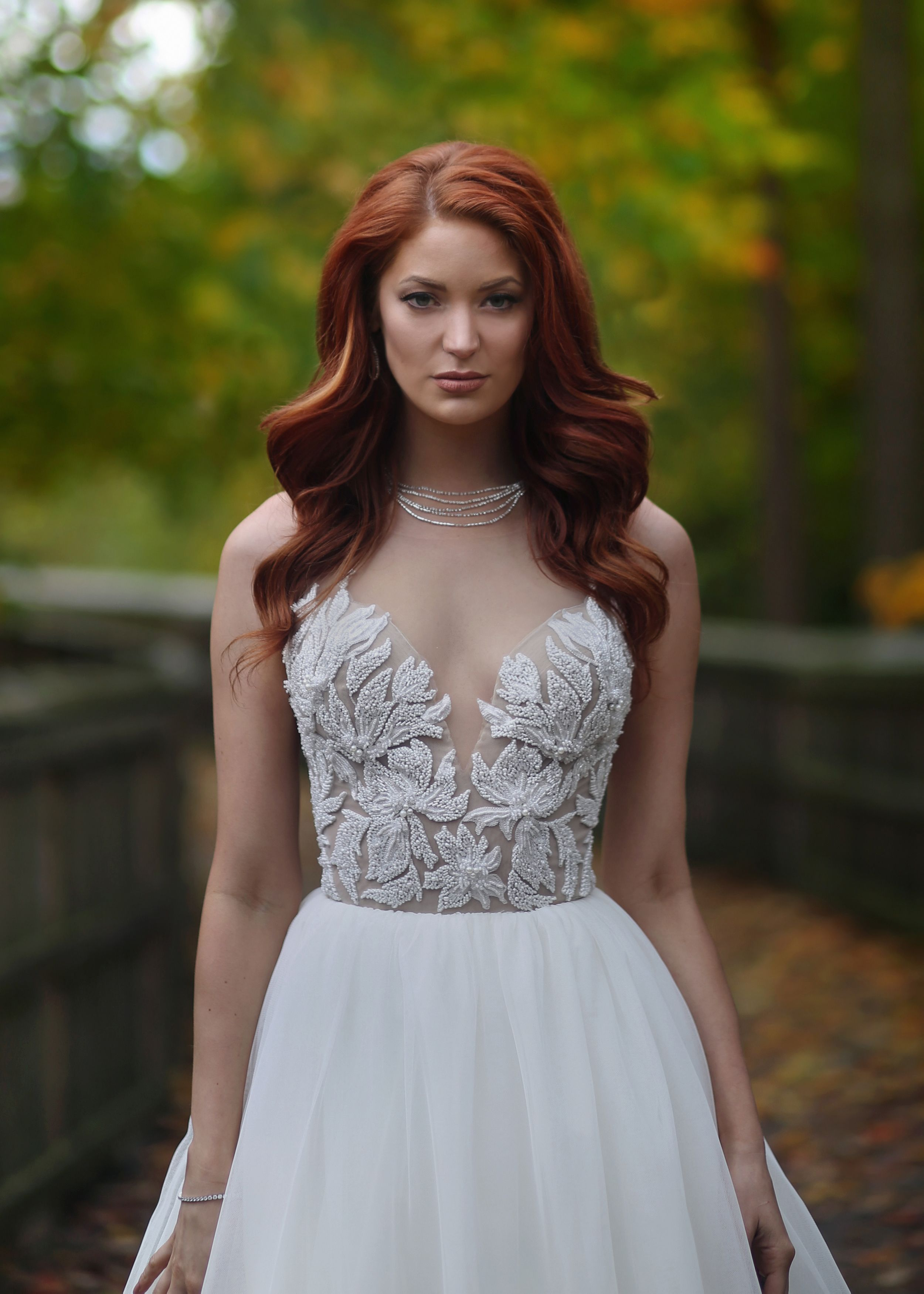 Plunging neckline beaded wedding dress from Solutions Bridal in ...