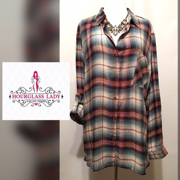 """PLUS 2XPink & Blue Plaid Tunic Blouse ‼️TREND ALERT‼️ Pink & Blue Plaid Tunic Blouse Adorably cute over leggings with boots or flats Soft satiny plaid patterned fabric button down with tabbed sleeves (not flannel) Hi low design New, tags attached  Size 2X Bust 25"""" across, 31-35"""" long 100% rayon  ‼️PRICE FIRM UNLESS BUNDLED‼️ Create a bundle for 15% off! Thanks for looking✌️❌NO PAYPAL❌NO TRADES❌ Hourglass Lady Tops Tunics"""