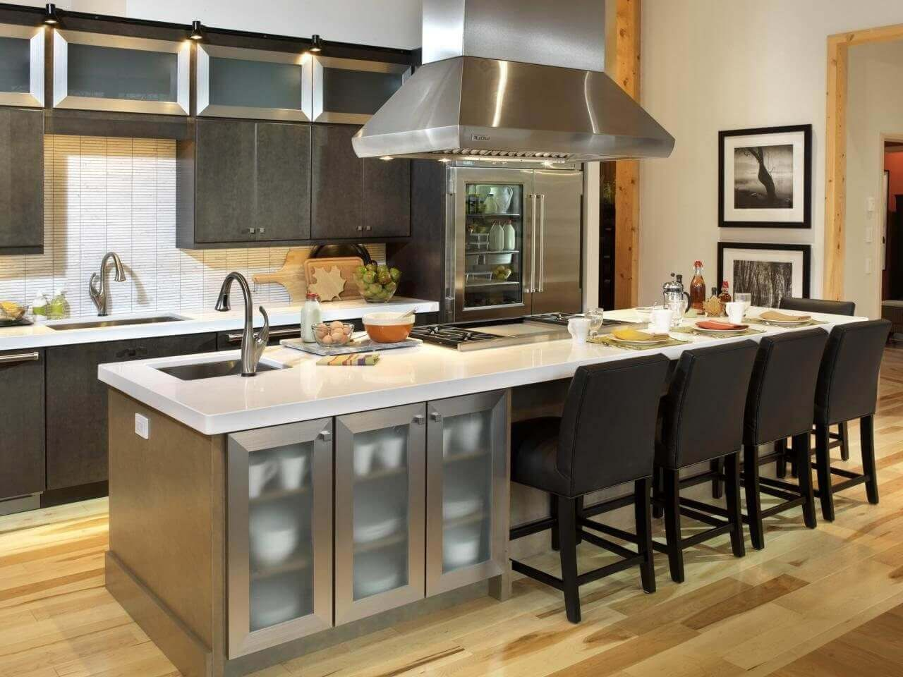 This Long Kitchen Island With Seating Has A Large Sink Cooktop And Stainless Steel Cupboard That Contribute To Its Luxurious Styling