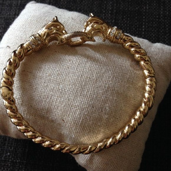 Chimera Bangle VINTAGE DISCONTINUED Stella & Dot Brass bangle with braided design, hidden closure. Very unique animalistic motif. Super rare and difficult to find. Excellent condition. Serious offers only please. Stella & Dot Jewelry