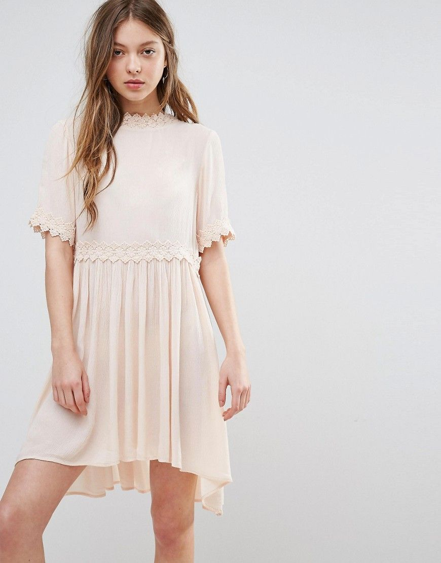 Buy it now. Vero Moda Smock Dress With Crochet Detail - Cream. Dress by Vero Moda, Semi-sheer lightly-textured fabric, High neck, Crochet-lace trims, Scoop back with strap detail, Regular fit - true to size, Machine wash, 100% Viscose, Our model wears a UK S/EU S/US XS and is 176cm/5'9.5 tall. ABOUT VERO MODA Danish fashion house, Vero Moda, made their mark on the fashion scene by using top models Kate Moss and Gisele Bundchen in their marketing campaigns. With emphasis on quality…
