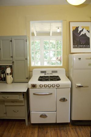 Love the vintage stove, fridge, and Hoosier cabinet