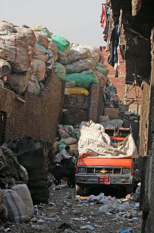 This Egyptian Neighborhood Is Buried In Trash, But That's Not The Most Shocking Part