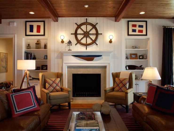 Nautical living room with ship wheel above fireplace and - Nautical theme living room ...