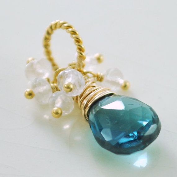 This is my first pendant! London blue topaz and rainbow moonstone, ready to slide onto that boring chain already in your jewellery box.