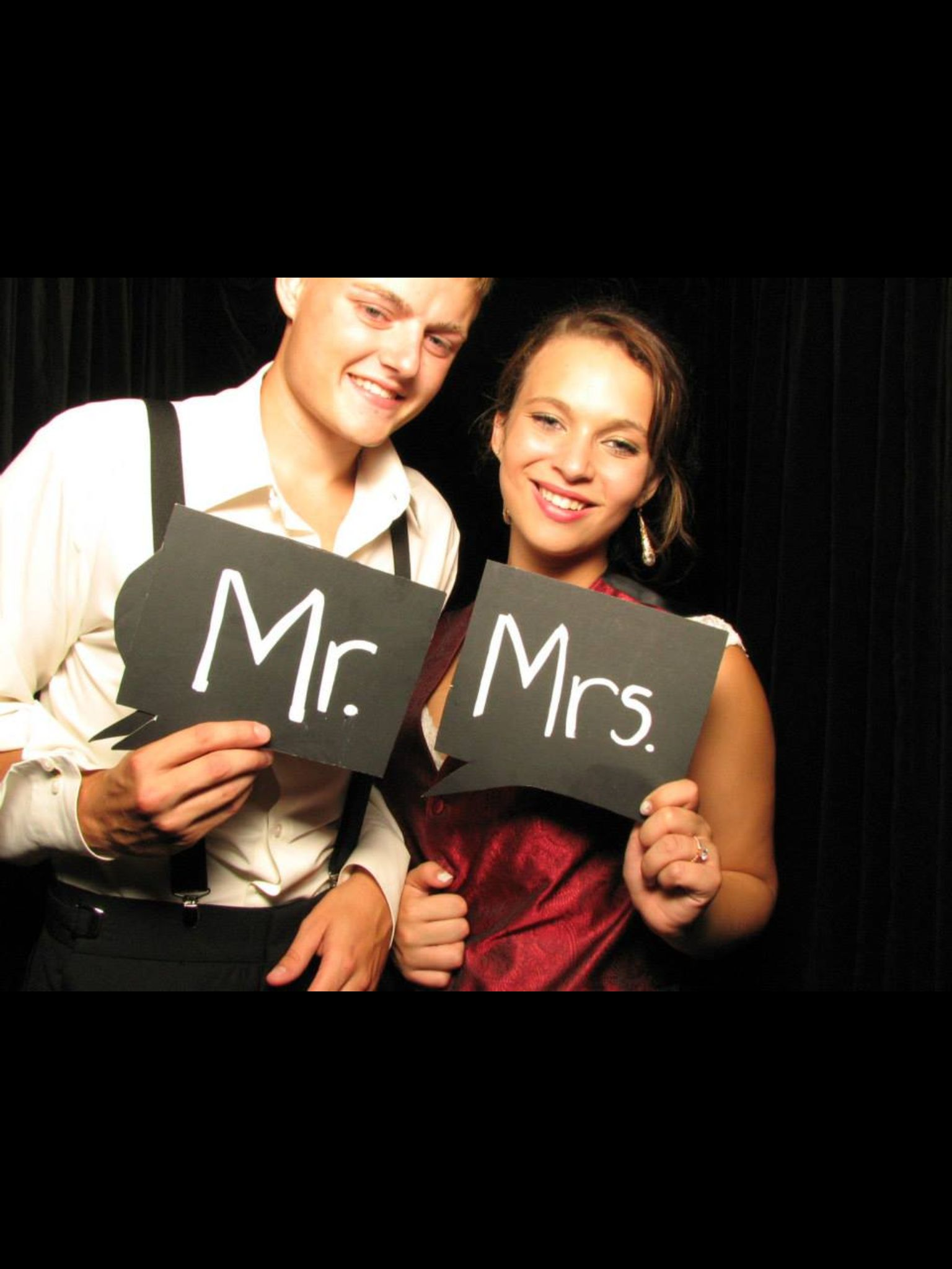 Photo booth is so fun. Made our own signs and props. Wedding photo booth