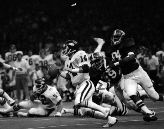 Alabama's Wayne Hamilton (94) and E.J. Junior (39) chase Arkansas quarterback Kevin Scanlon (14) in the Sugar Bowl at the Louisiana Superdome in New Orleans on Jan. 1, 1980. Alabama won the game 24-9. (Birmingham News file)