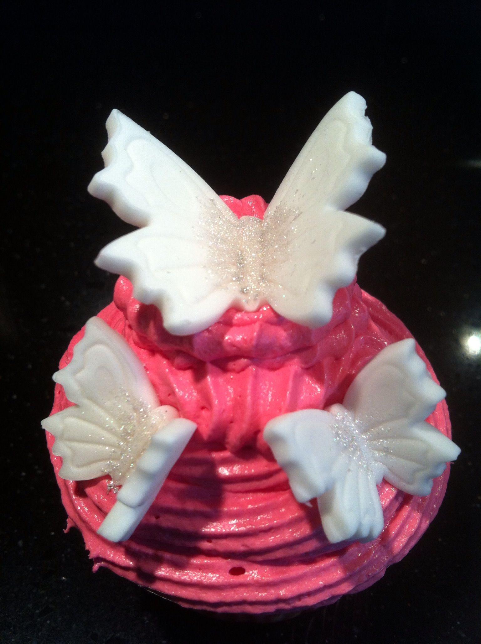 Cupcake met witte vlindertjes