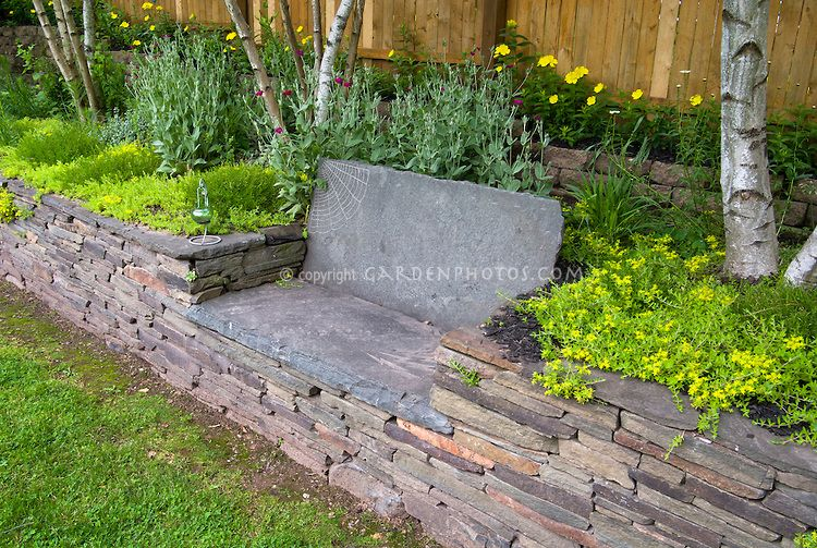 Under tree patio bench raised bed stone garden bench in raised bed stone wall fence birch Stone garden bench