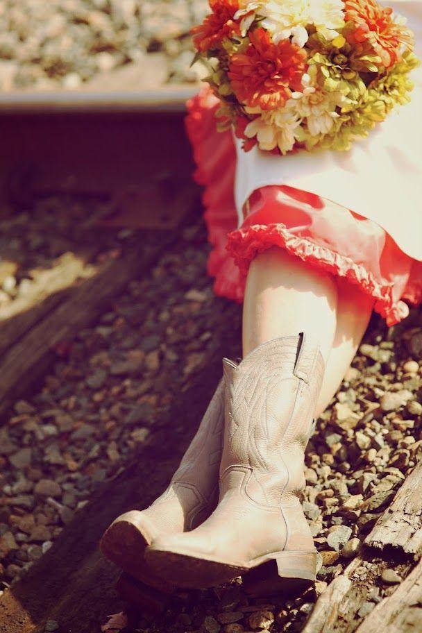 cowboy boots + knee-length dress + pink crinoline