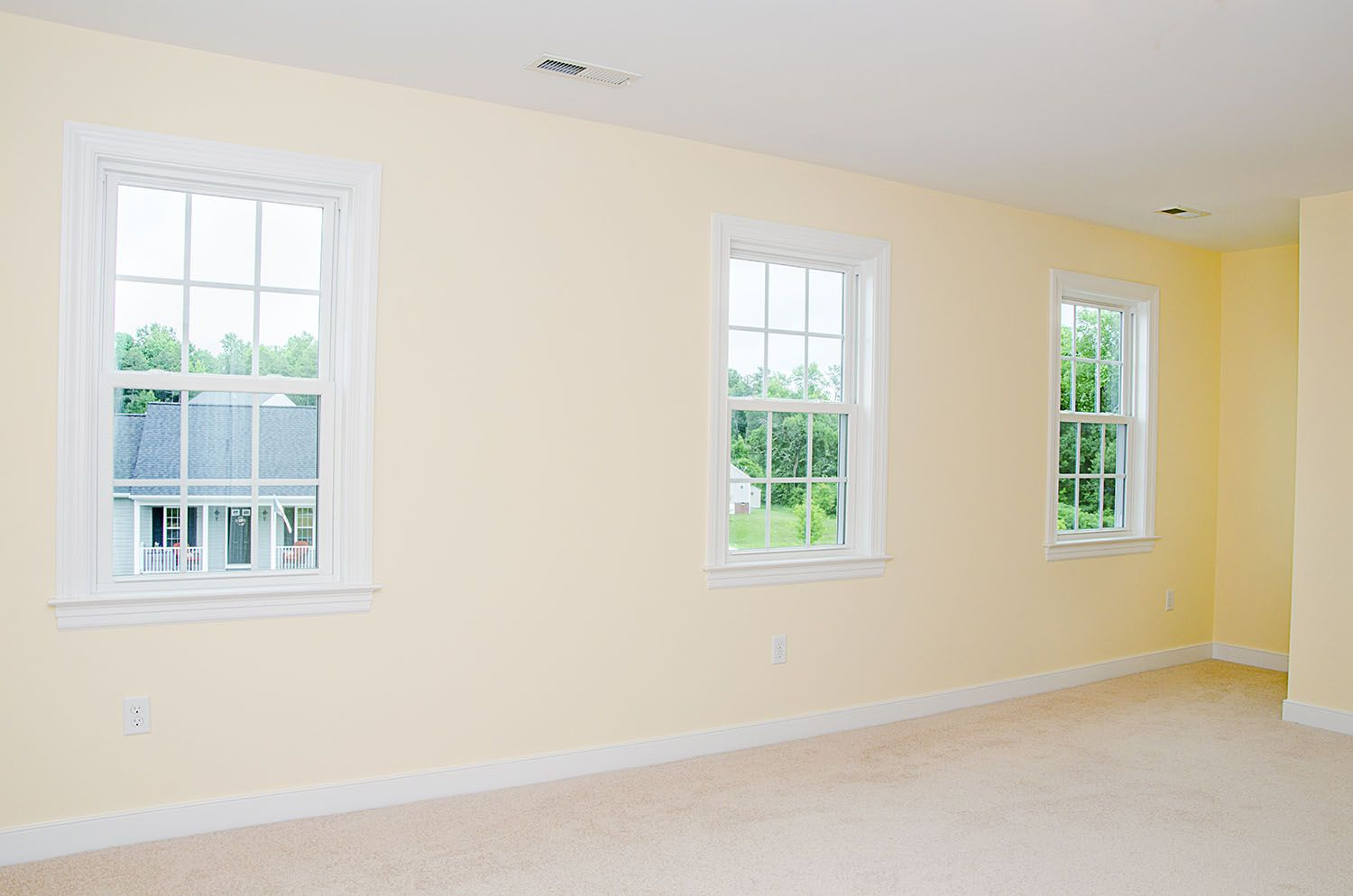 Master bedroom suite with a trio of windows that allot for lots of natural light ©Balducci Builders