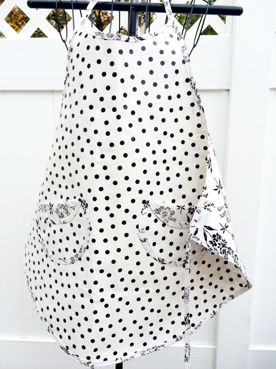 Apron - Oilcloth Apron - Black and White Polka Dot Oilcloth and Floral Print Reversible Apron by LindasOtherLife on Etsy