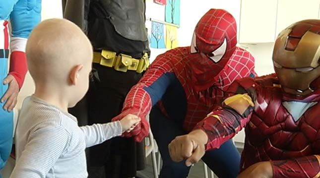 Wow!  Window washers dressed as superheroes to give children's hospital kids a little bit of joy!