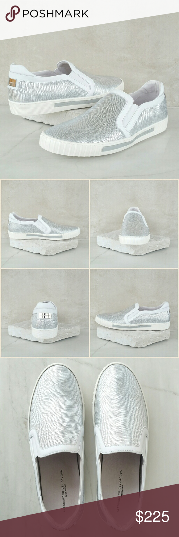 "ALESSANDRO DELL'ACQUA silver leather sneakers Snakeskin embossed calf leather silver sneakers. Rounded toe. Slip on construction with elastic opening. White leather trim. Silver metal hardware with logo at the back of shoes. Leather upper, leather lining, leather insole, rubber outsole. Approximately 1"" platform sole. Made in Italy. Size: IT 44 / US 11. Color: silver / white.  NWB. Never worn. Comes with original box and dust bag. Can provide more pictures and info upon request. Reasonable…"