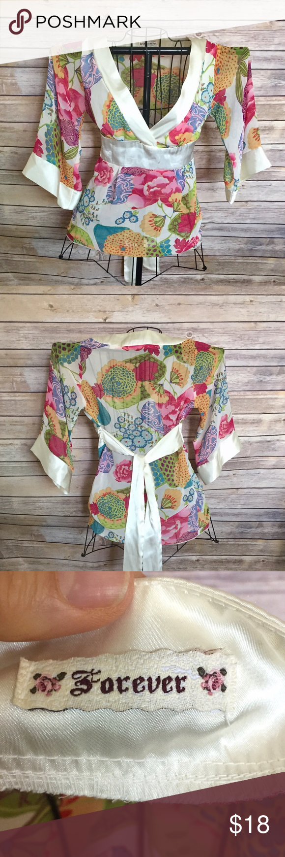 Beautiful floral blouse BEAUTIFUL floral kimono style blouse in vibrant shades of , pink , yellow, blue green orange , satin trim sleeves , hem & waist & attached tie belt , size tags have been removed but it's a size small forever Tops Blouses
