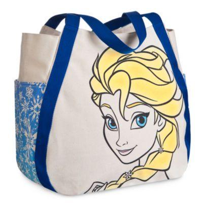 """Mit der """"Elsa""""-Tasche trägst du überall den Zauber aus Arendelle mit dir herum. Der Star aus """"Die Eiskönigin - völlig unverfroren"""" ziert eine ganze Seite der Henkeltasche aus Leinen, während die andere Seite mit einem kleinen Motiv versehen ist. Die Seitentaschen besitzen ein cooles Schneeflockenmuster."""