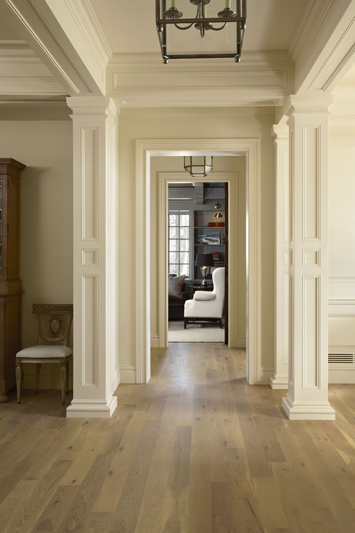 The hallway in a newly constructed house by murphy co for Crown columns