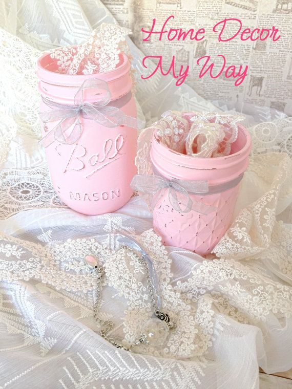 Let me introduce you to our lovely Pink Mason Jar Set, embellished with Silver organza ribbon. This delicate and feminine set was inspired by those vintage fashion magazines from the 50s. I immensely enjoyed the process of combining my ribbon collection with this beautiful pink chal paint, until i found that silver was the perfect match for it. This set offers you the possibility of 3 flower vases, depending on how you want to style it. You can also store makeup brushes, pens and pencils…