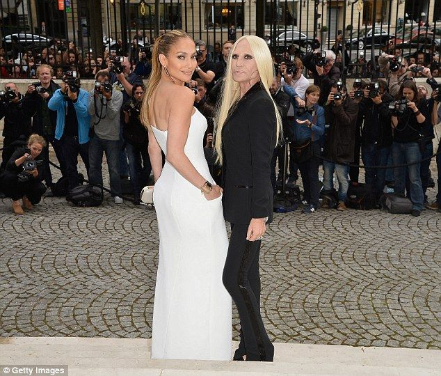 Designer and muse: Jennifer poses with designer Donatella Versace at the high-profile event