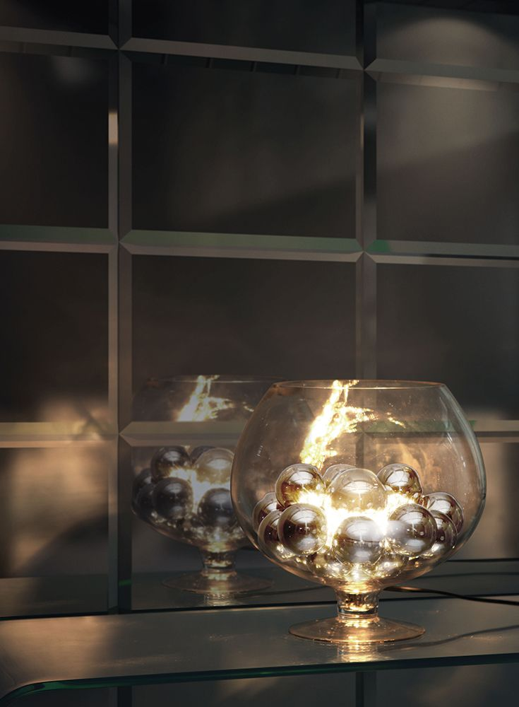 The elegance of chrome orbs enhances the look of this unique table lamp. The Terran lamp has one 40W bulb that shines and reflects off of the chrome spheres.