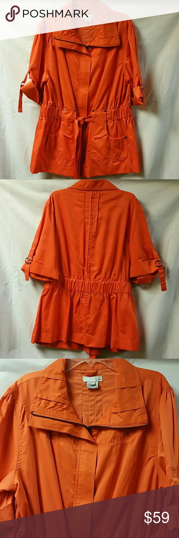 "Fall utility jacket. Great color!! Size XL This is a bright orange utility jacket, perfect for Fall. Jacket is not as bright as photo. Picture 3 depicts true color. Kind of a pumpkin orange, just a bit brighter. Worn once, excellent condition. Hidden zipper, longer short sleeves, two front pockets, elastic wide waistband with attached belt. Measures approx. 27"" in length, bust measures approx. 38"". Size XL. Lux Jackets & Coats Utility Jackets"