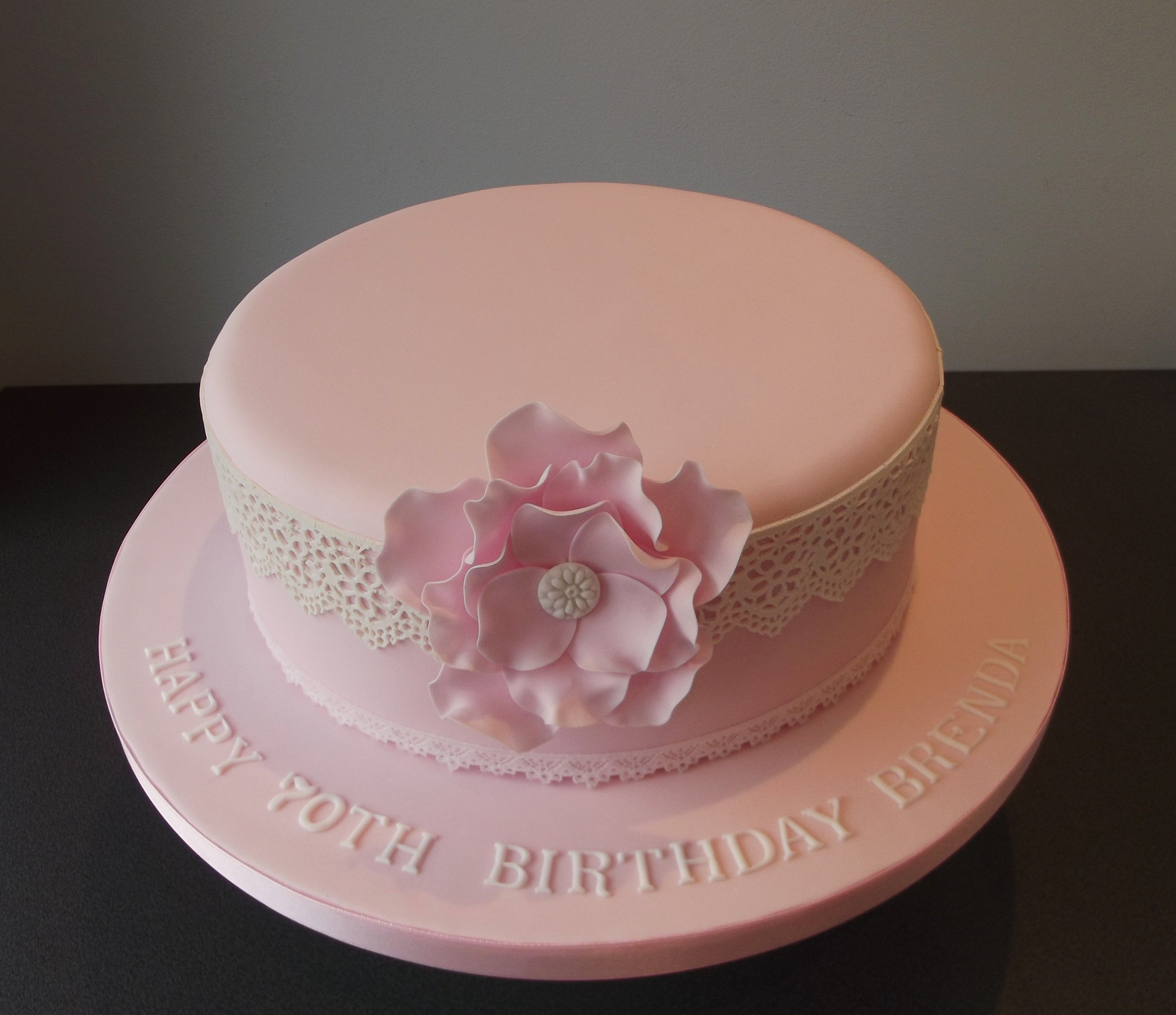 Pink lace birthday cake with flower and edible lace 70th Birthday