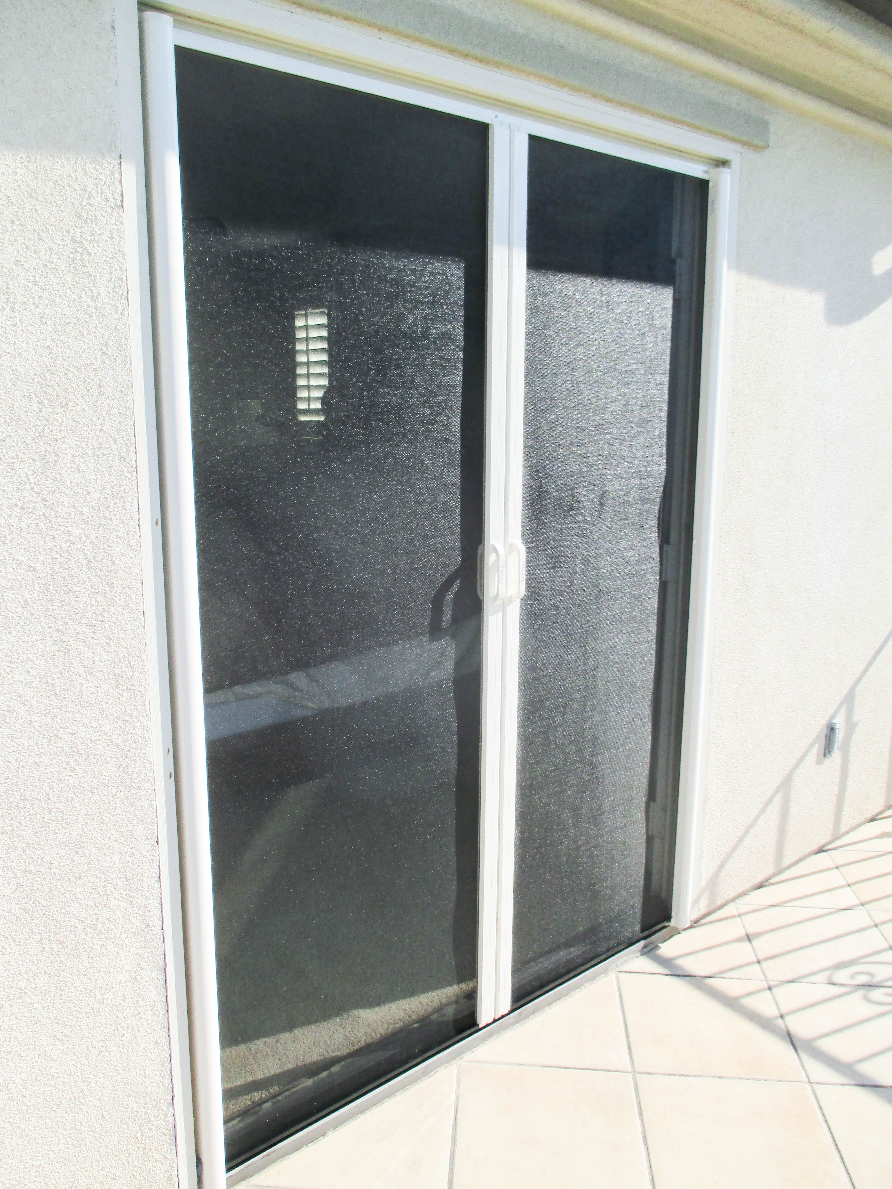 Check Out These White Framed Double Retractable Screen Doors With