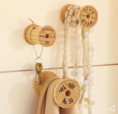 antique bobbins as necklace hooks! GENIUS. Would be lovely near a bathroom mirror for usage before a shower or bath.
