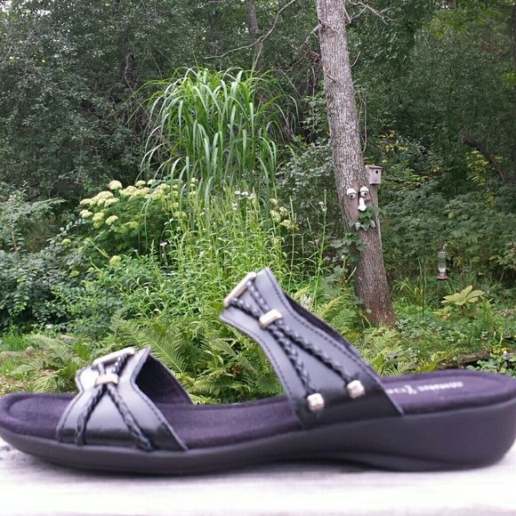 Minnetonka Monterey Sandals Final Markdown! Perfect casual style and great quality sandals. Like new condition. Leather upper with braids and metal hardware. Lightly padded suede covered footbed. Minnetonka Shoes Sandals