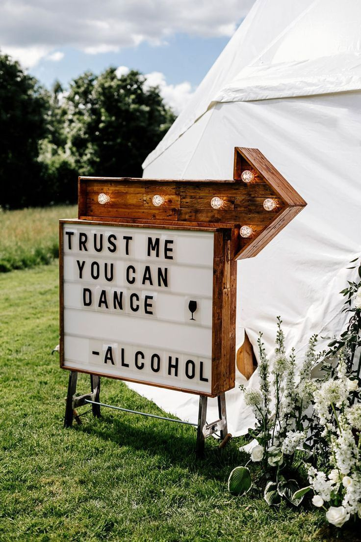 Rule number 1 of a festival themed wedding: invest in lots of cool festival wedding signs! We love this one. Click to see more festival wedding decor ideas...