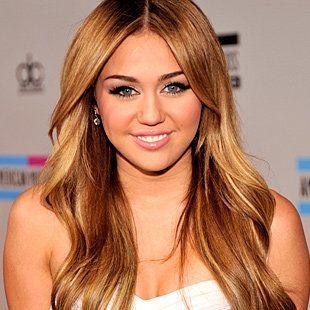Miley Cyrus with natural highlights and long hair