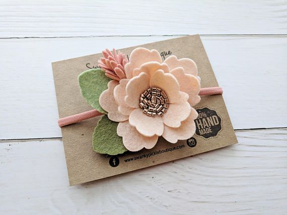 This listing is for one wool felt big flower headband in blush pink and soft coral. The flower is accented with a rose gold metallic faux leather center and a mix of light and dark green leaves. The flower and leaves measure approximately 3.75 x 3. Measurements of the flower and #feltflowerheadbands