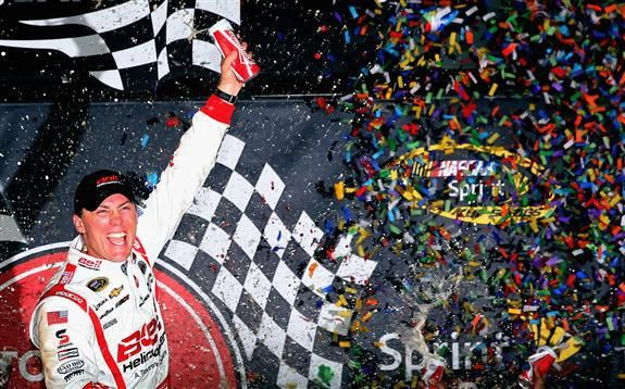 Kevin Harvick, driver of the #29 Bell Helicopter Chevrolet, celebrates in Victory Lane after winning