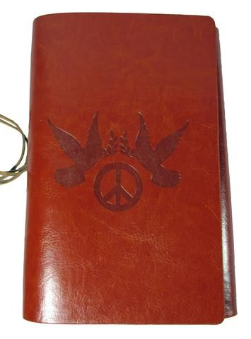 This hand embossed Dove & Peace Journal conveys a timeless symbol of compassion, love, and peace. The leather tongs are adorned with cast-metal peace symbols. A perfect journal for inspirational messa