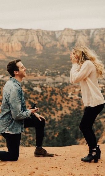 I love this! And their outfits go so well together. How beautiful. #engaged #justengaged #engagementphotos