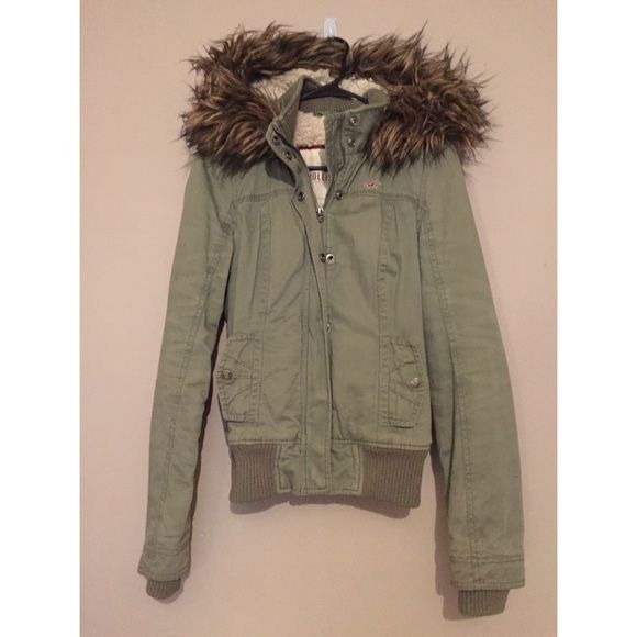 Army Green Fur Lined Jacket by Hollister Army green color, fur lined on the inside of the coat and hood. Two side pockets. Zip and snap closure. Removable fur on hood. Back tie. 100% Cotton exterior, 100% Polyester sleeve lining, Faux fur.   Fast Shipping!  Send offers!  Don't forget to bundle!  No trades!  Hollister Jackets & Coats