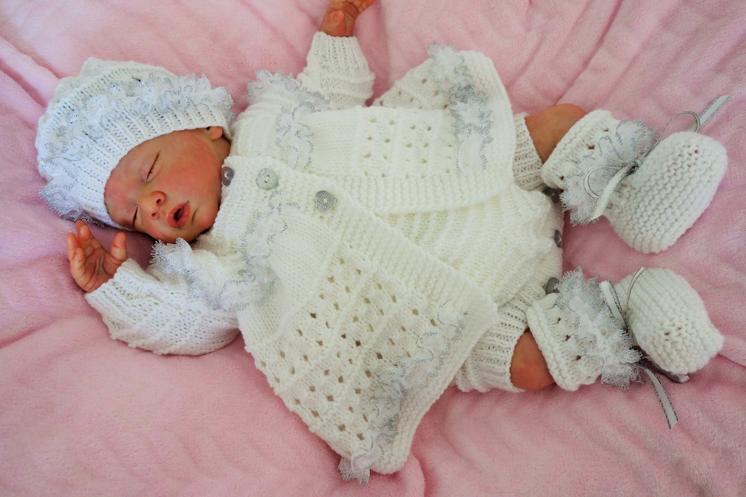 3a1269329 Hand knitted baby s romper set in white with matinee coat