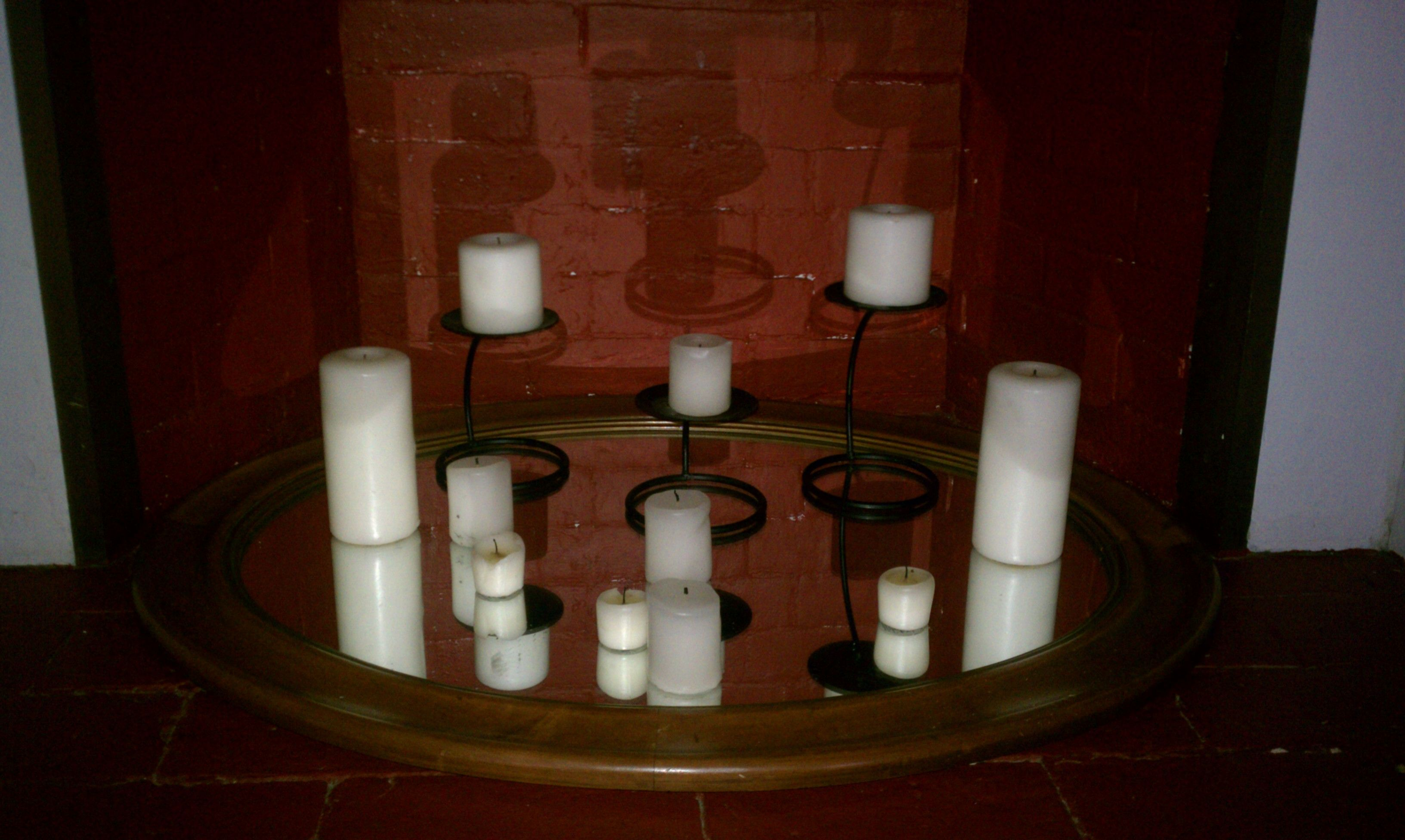 Candles on top of a mirror in a non-working fire place ... on Decorative Wall Sconces Non Lighting id=38562