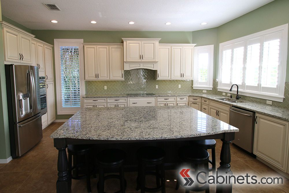 Large open kitchen with deerfield springfield maple antique white chocolate glaze cabinets wall - Antique white cabinets with black glaze ...