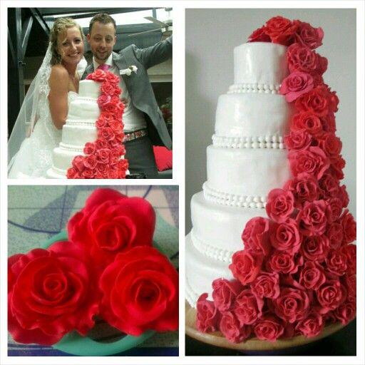 Weddingcake with waterfall of roses