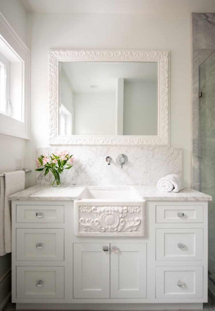 The Carved Marble Farmhouse Sink Is Integrated With Classic White Shaker Cabinets And Carrera Marble Tops Farmhouse Sink White Shaker Cabinets Marble Bathroom