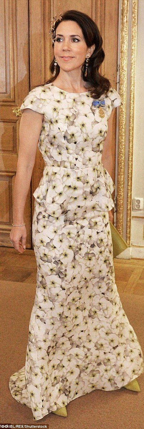Feminine in floral: The princess took a risk in a floral full-length gown and yellow stilttos