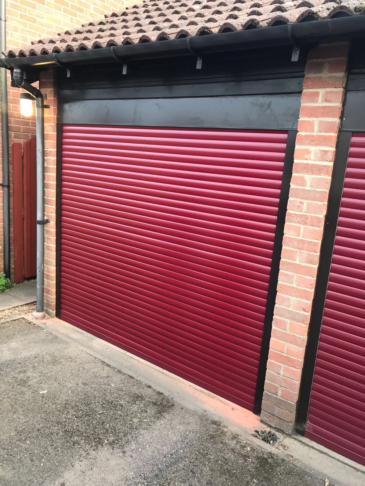 Red Insulated Roller Garage Door With Black Guides And Box