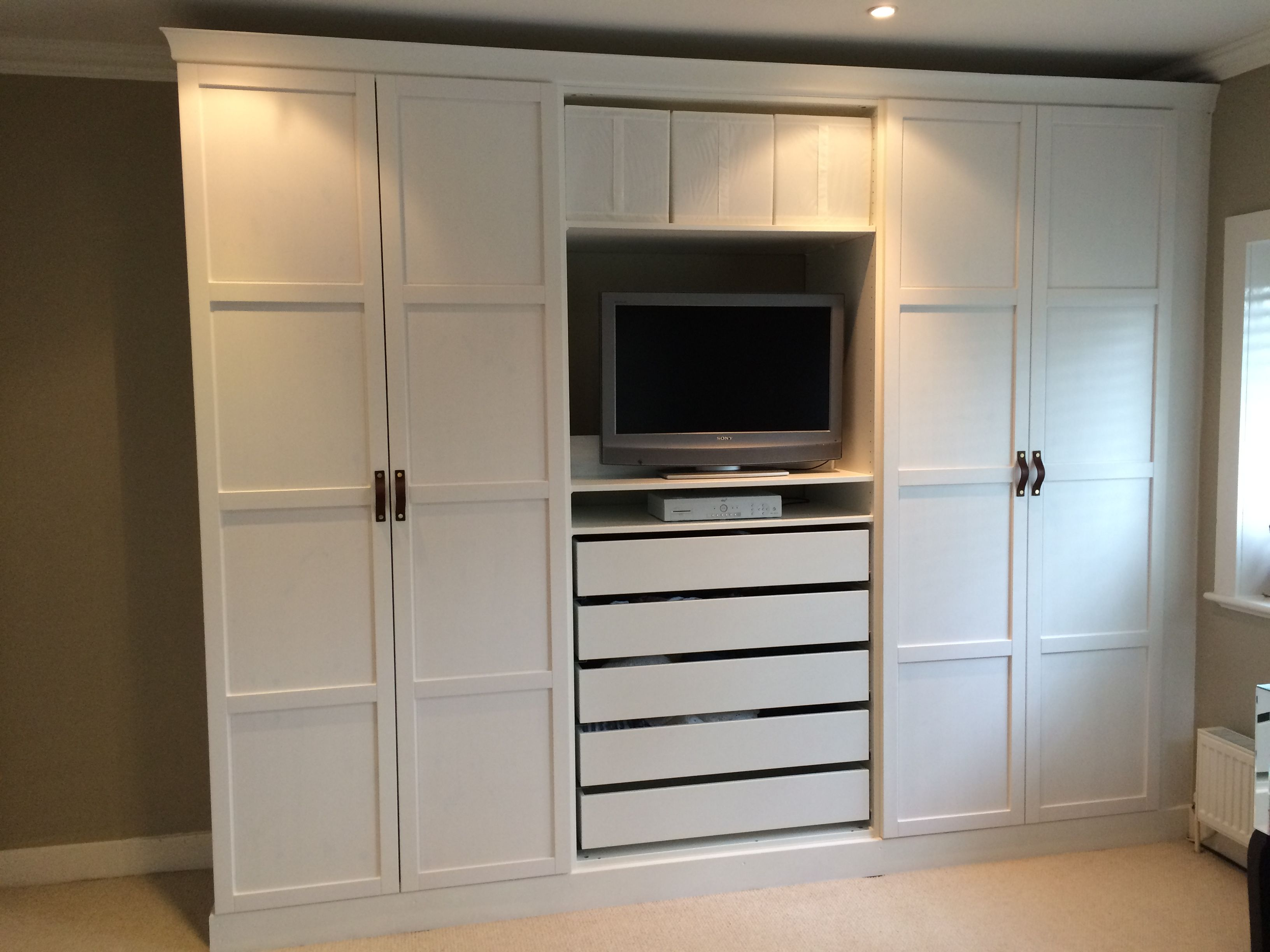 Ikea pax wardrobes hacked to look built in with leather for Bedroom ideas with built in wardrobes
