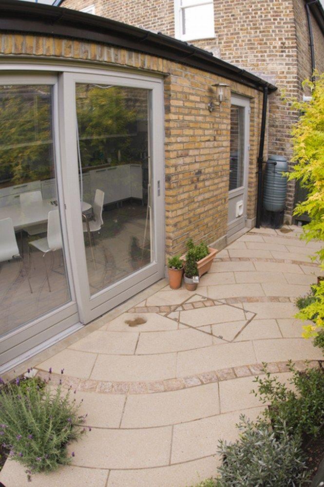 Courtyard garden in East London Brick planter, Concrete