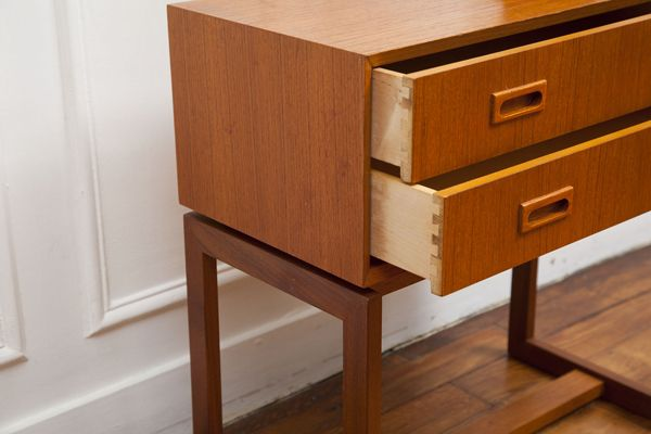 Mid century small teak commode.  Base with rectangular frame on sides.
