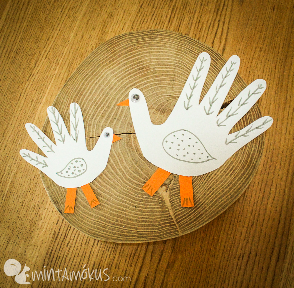 Mother goose and her little one. Easy paper craft made of hand shapes x