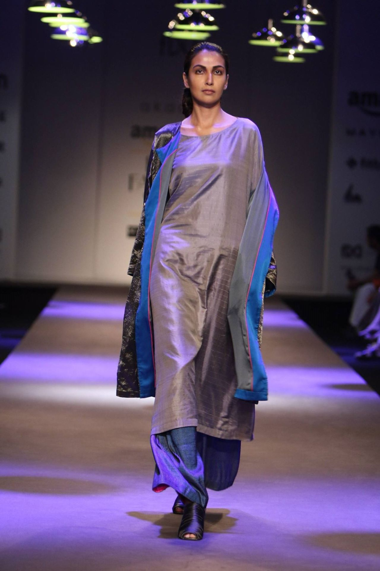 Gourav Jai Gupta displayed a collection of contemporary outfits at Amazon India Fashion Week Autumn/Winter 2016. The designer used bright and shiny material giving the show a slightly futuristic vibe. #amazonfashionweek2016 #aifw #catwalk #model #indianfashiondesigners #fashionshow #winter #autumn #gauravjaigupta #fashiondesingers #strandofsilk