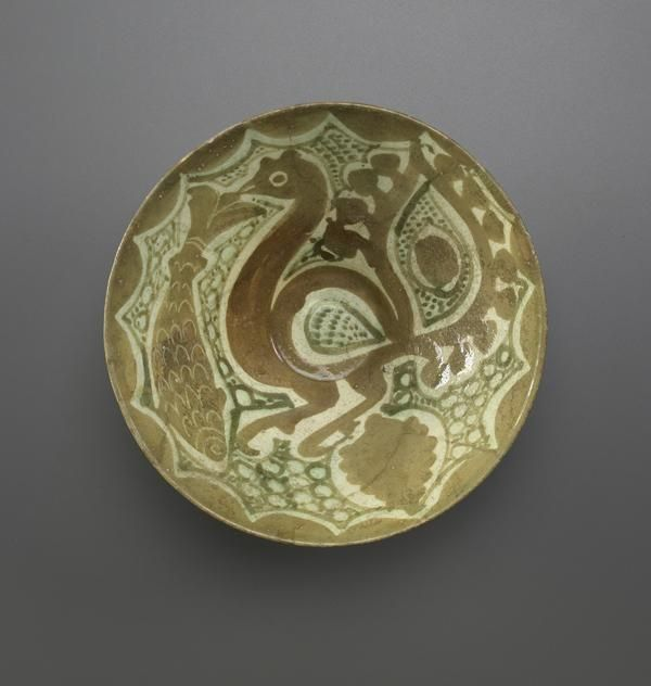 Deep bowl, earthenware painted with slip under transparent glaze. Iran, 10th-11th century Available Photograph and description taken from Freer and the Sackler (Smithsonian) Museums.