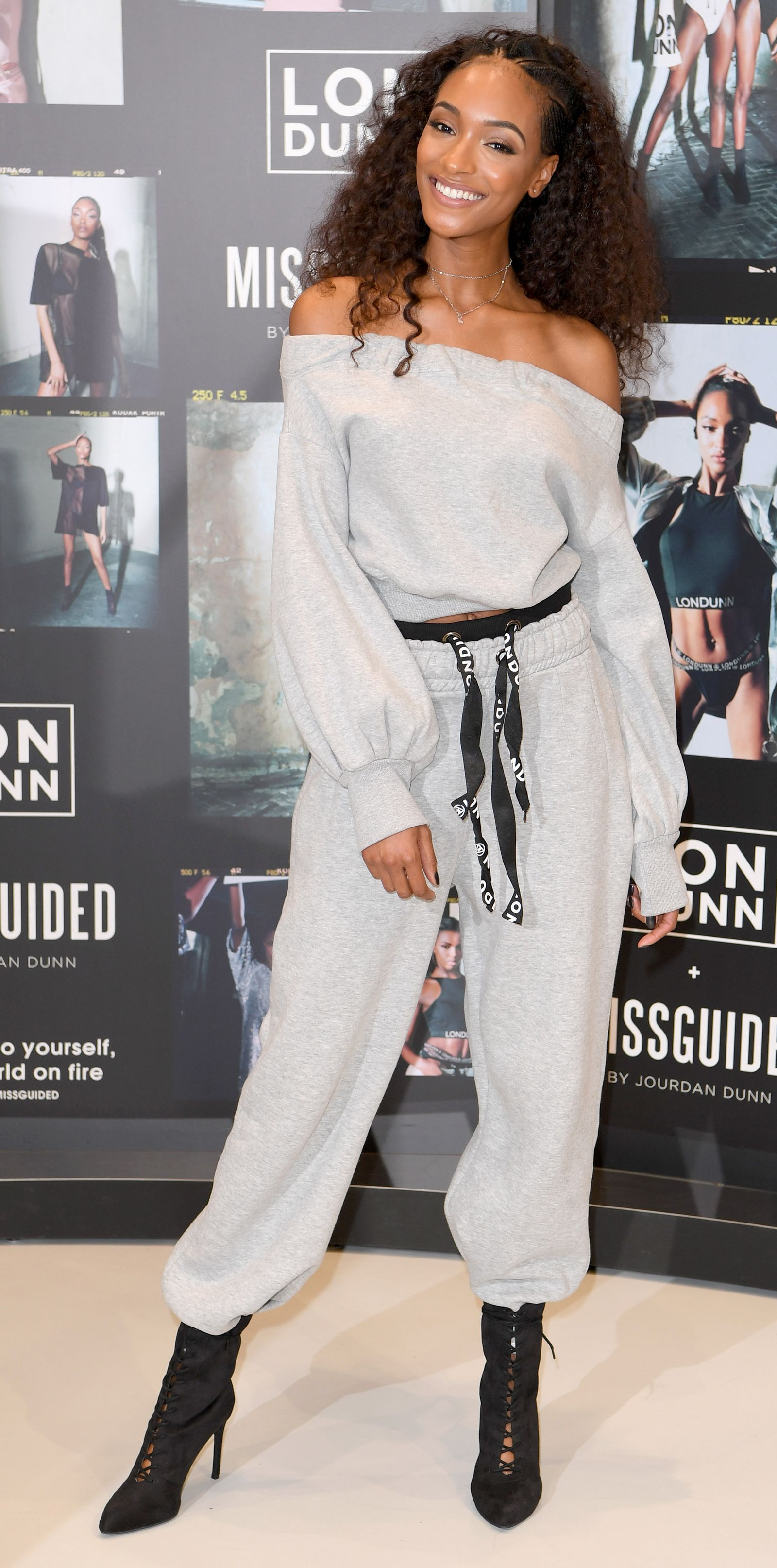 Jourdan Dunn showed us athleisure at its finest while at the launch for her clothing collaboration with Missguided. She wore an off-the-shoulder sweatshirt and matching sweatpants with contrast logo drawstrings and elastic waistband. Lace-up booties and layered chokers completed the look.